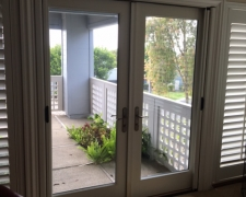 ALABASTER CUSTOM COLOR FRENCH ROLL-AWAYS ON OUTSWINGING DOUBLE DOORS