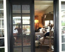BLACK FRENCH ROLL-AWAY WITH FIXED DOOR ASTRAGAL PINNED IN PLACE