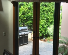 BRONZE FRENCH ROLL-AWAYS ON OUTSWINGING WOODEN DOORS