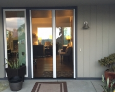 TALL WHITE FRENCH ROLL-AWAY RETRACTABLE SCREEN DOORS IN USE