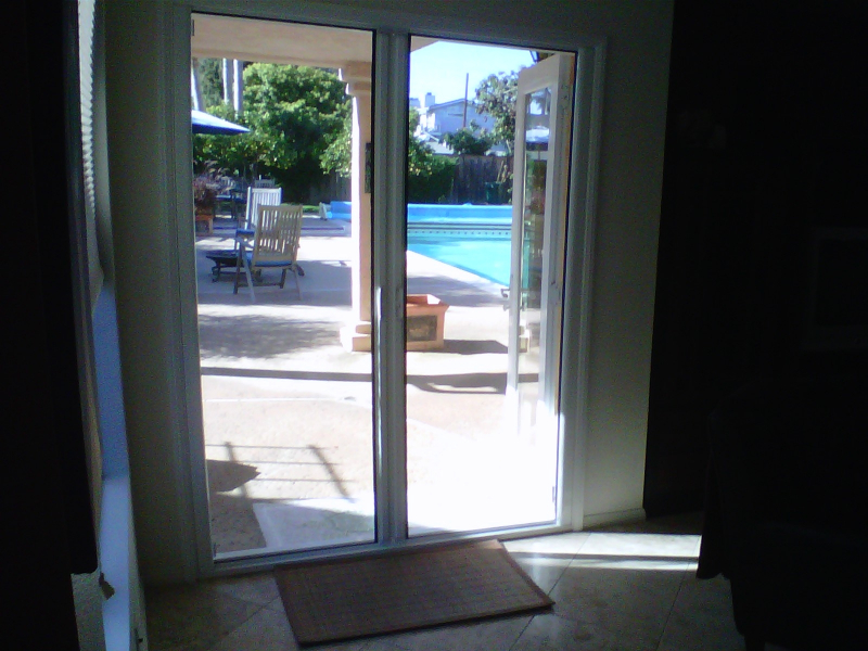 Roll away retractable screen doors double the screen for Rolling french doors