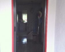 BRONZE ROLL-AWAY SCREEN DOOR IN USE