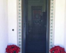TALL BRONZE ROLL-AWAY RETRACTABLE SCREEN DOOR IN USE