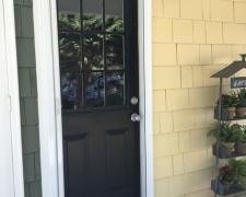WHITE ROLL-AWAY SCREEN DOOR ON DUTCH DOOR