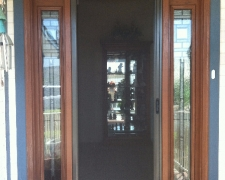 BRONZE ROLL-AWAY DISAPPEARING SCREEN DOOR IN USE