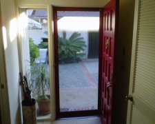 RUBY RED CUSTOM COLOR TRU-VIEW SECURITY SCREEN DOOR LOOKING OUT