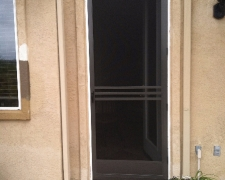 TALL BRONZE CLEARVIEW SWINGING DOOR WITH CUSTOM CROSS BARS