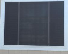 OVERSIZED SOLAR SCREEN WINDOW